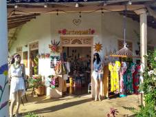 Artemania, clothes and trinkets of many colours for sale