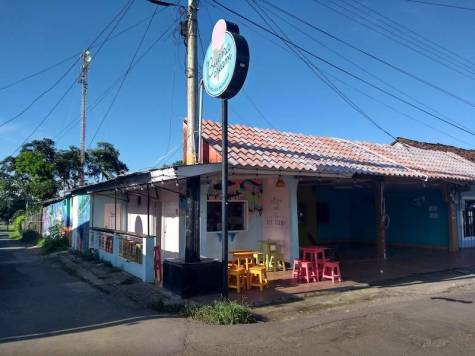 Small ice cream shop, decorated in pastel blue and pink