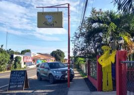 Smiley's restaurant sign and cutout figure