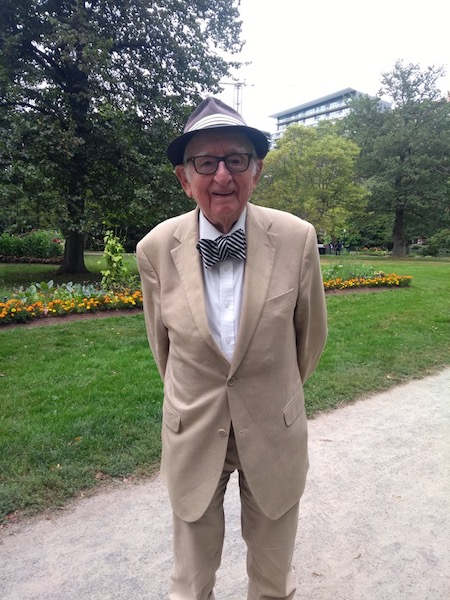 88 year old in suit, bow tie and pork-pie hat