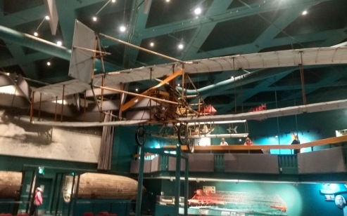 Old biplane hanging from the ceiling