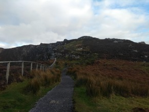 Flat path heading to a rocky path upwards