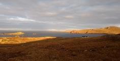 Sun shines over an arid seaside landscape