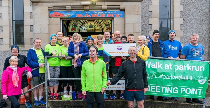 Group of runners, walkers and volunteers outside the cafe