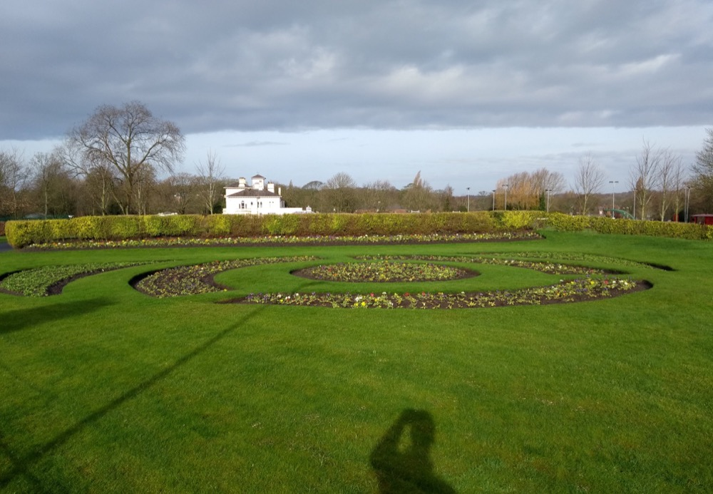 Flowers arranged in circular beds on an immaculate lawn