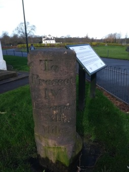 Historic mile marker made of stone - now in the park, rather than on the road