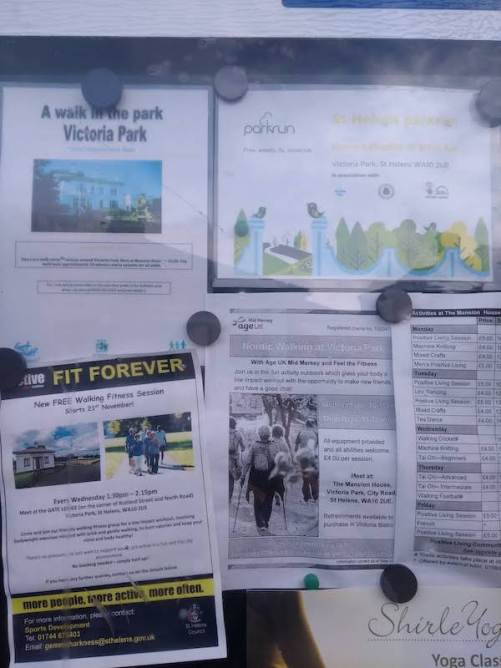 parkrun advertised on a signboard, along with walking in the park, and 'fit forever'