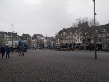 Large cobbled square, with town houses on the sides.