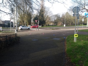 An arrow and cones show where we turn left onto the pavement