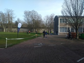 A parkrun flag and the finish line, next to the EDLAB building