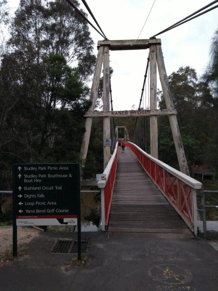 Suspension bridge with red pedestrian barriers