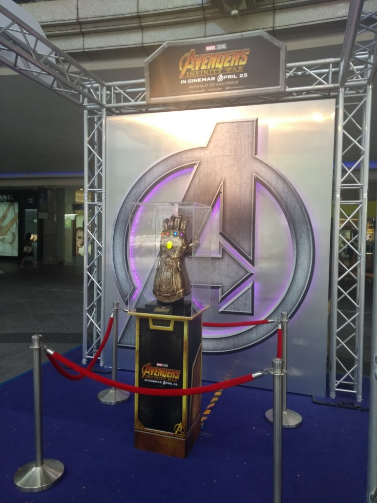 Thanos' Gauntlet on display outside a cinema, in front of a large A for Avengers