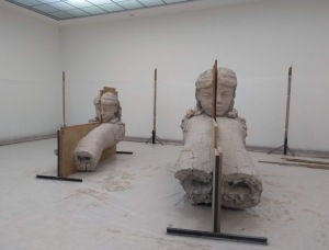 Large clay people, presented as a work in progress