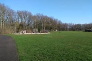 Playground on a lush field.